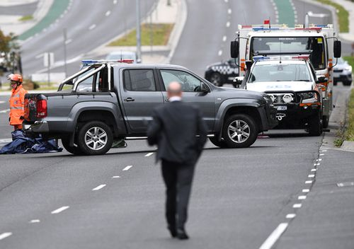 Police teams search an abandoned ute believed to be involved in Paul Virgona's slaying. The Volkswagon Amarok was ditched on The Mountain Highway in Bayswater.