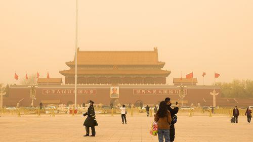 Tiananmen Square, shrouded in sandstorms in Beijing, China.