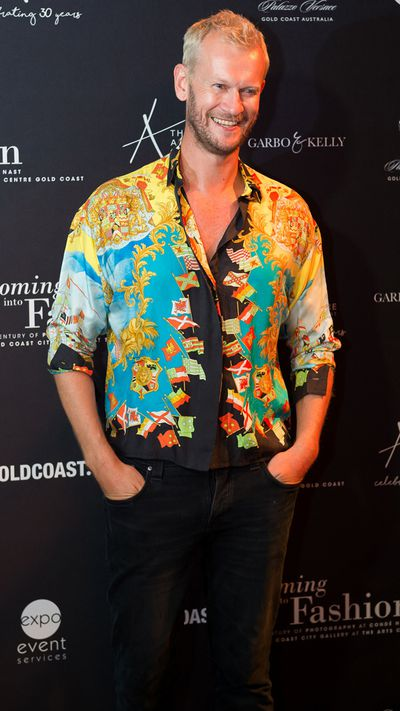"""9Style editor Damien Woolnough at the opening of <a href=""""https://theartscentregc.com.au/gallery/coming-into-fashion/"""" target=""""_blank"""">Coming intoFashion at the Arts Centre Gold Coast.</a>"""