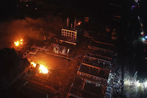 Fires burned at the site of a factory explosion in a chemical industrial park in Xiangshui County of Yancheng in eastern China's Jiangsu province well into the night. (Ji Chunpeng/Xinhua via AP)