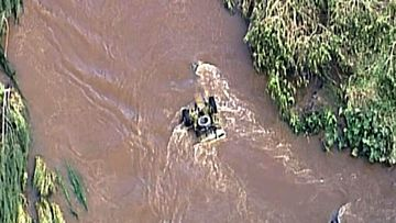 Swift water rescue crews are this afternoon attempting to recover an overturned ute that police say belongs to missing man David Hornman.
