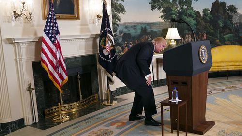 Trump searches for water during a speech on Nov. 15, 2017. Photo: AP