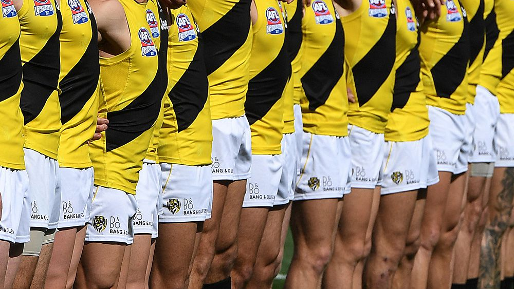 AFL integrity unit open investigation into Richmond topless photo scandal