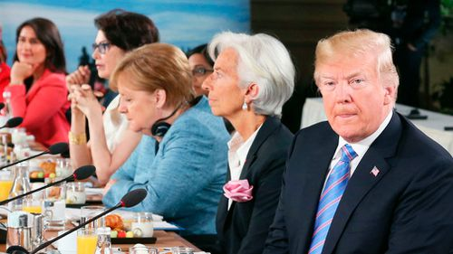 Donald Trump, pictured on Saturday at a meeting with German prime minister Angela Merkel, backed out of signing the group's joint statement. Picture: AP
