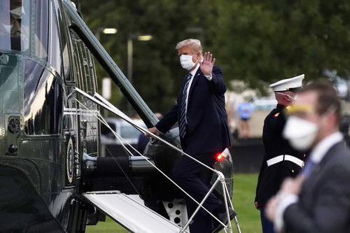 President Donald Trump boards Marine One to return to the White House