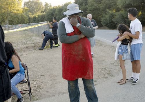 People leave the Gilroy Garlic Festival following a shooting in Gilroy.
