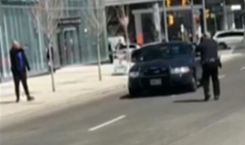 The suspect tries to threaten the officer. (CTV News)