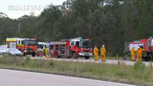 Part of the highway was closed as emergency vehicles attended the scene. (9NEWS)