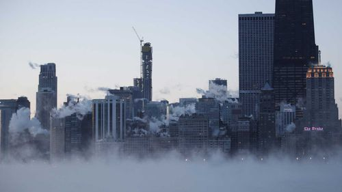 Steam rises over the city of Chicago as the city shivers through -29C temperatures.