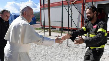 Pope Francis greets the faithful at a fire station base camp in Cittareale. (AAP)