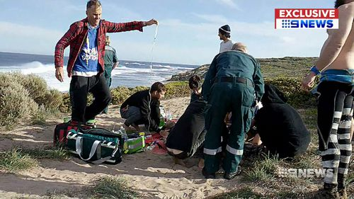 The surfer was given first aid before paramedics arrived. (9NEWS)