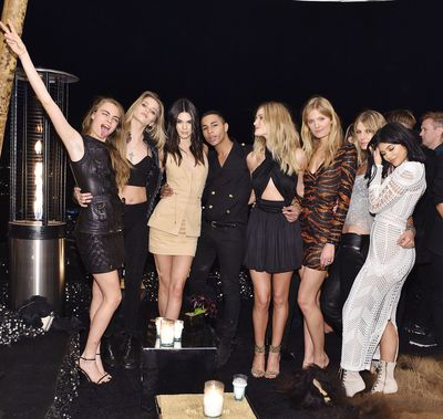 To celebrate 30 years on earth, Balmain's creative director Olivier Rousteing threw himself one helluva birthday bash at a private residence in Laurel Canyon, Los Angeles. The guests (mostly supermodels and Kardashians) enjoyed a performance by Tyga, drinks, dancing and a black and gold Balmain-inspired birthday cake. Click through for your inside look.