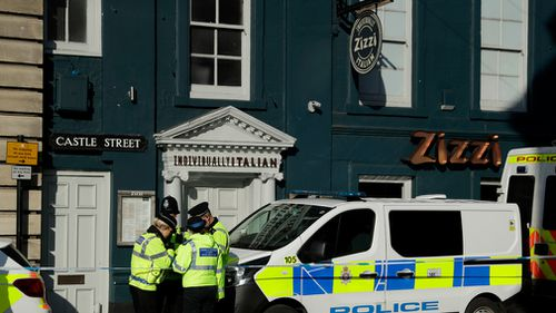 Police swarm the Zizzi restaurant where the pair ate on Sunday. (AAP)