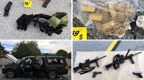 Weapons and ammunition carried by suspects involved in a mass shooting, at the scene of a shooting with an officer, in San Bernardino, California. (AAP)