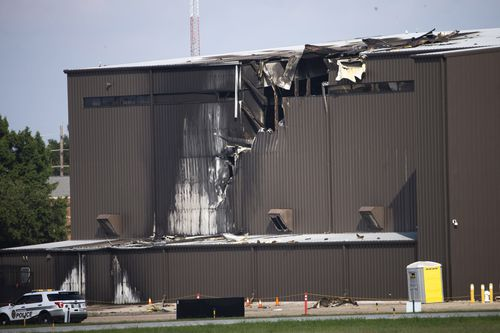 Ten people were confirmed killed when a private plane crashed into the side of a hangar at Addison Municipal Airport on Sunday.
