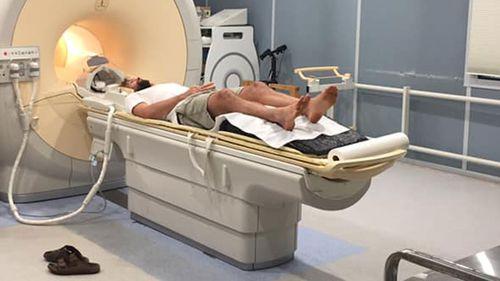Joel North undergoing an MRI scan.