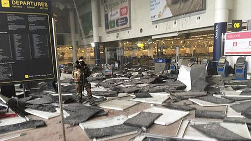Damage inside the Zevantem Airport departures hall. (Twitter)