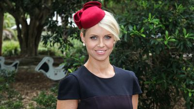 Small, pill-box hats like this red felt creation by Dianne Barbour Millinery are perfect for remaining nimble in large crowds at major race days. (Sydney Event Blogger)