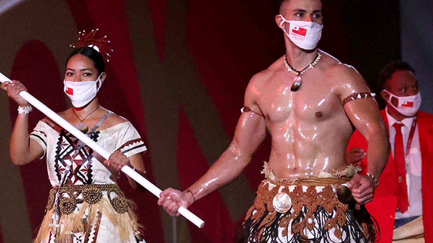 Pita Taufatofua leads the Tongan team out at the Tokyo Olympics.