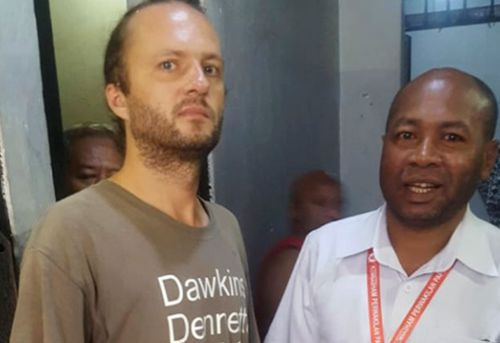 Polish national Jakub Skrzypski, left, who is detained and charged with treason on accusation of assisting Papuan independence supporters and separatist fighters talks with the head of Papua Representative Office of the National Human Rights Commission Frits Ramandey.
