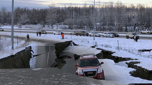 Cars were left stranded as roads buckled in the two earthquakes in Alaska.