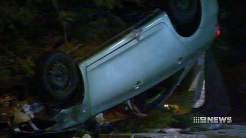 The Yaris driver escaped the crushed and flipped car and fled the scene without checking on Ms Paterson. (9NEWS)