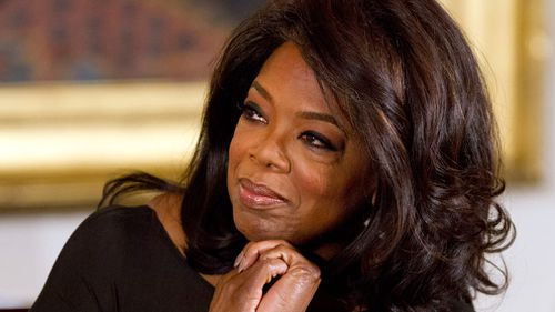 Oprah Winfrey listens in the East Room of the White House in Washington in November 2013. (AAP)