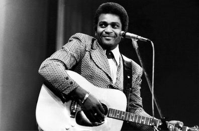 Charley Pride performs on a TV show, London, February 1975.