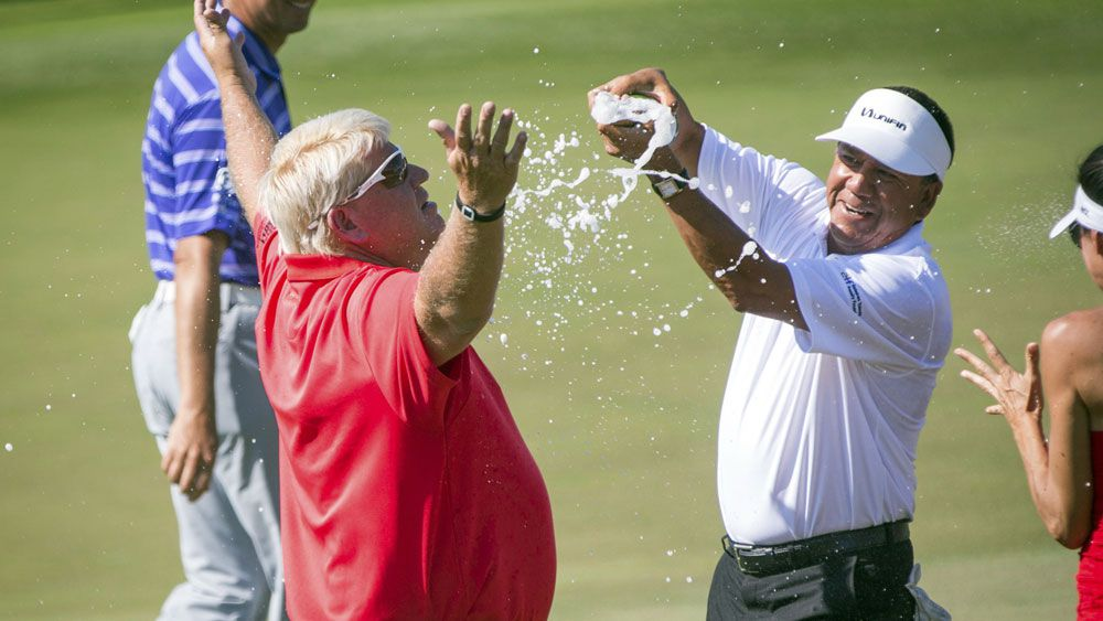 John Daly is showered in champagne after winning his first tournament in 13 years. (AAP)
