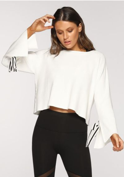 "<a href=""https://www.lornajane.com.au/-collection/-tops/courtside-cropped-knit/p-091814_W"" target=""_blank"" title=""Lorna Jane Courtside Cropped Knit, $85.99"" draggable=""false"">Lorna Jane Courtside Cropped Knit, $85.99</a>"