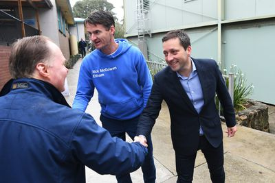 Liberal candidate for Eltham Nick McGowan and Victorian Opposition Leader Matthew Guy greet voters.