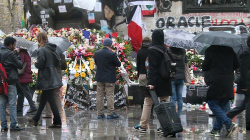 People visit the Place de la Republique to offer flowers to mourn the victims of the Paris terror attacks one week on. (AAP)