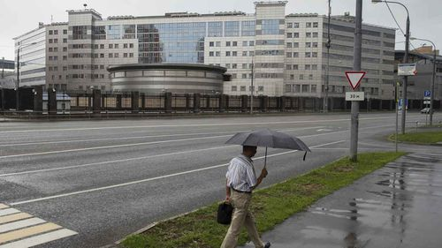 A man walks past the building of the Russian military intelligence service in Moscow, Russia. (AAP)