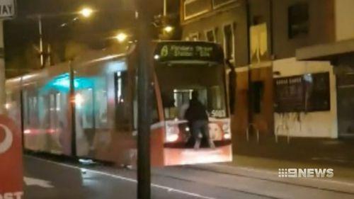 A man tram-surfing in Melbourne.