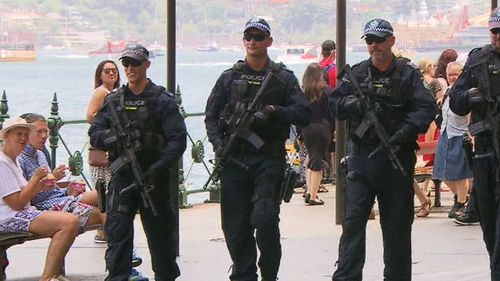 Dozens of riot squad members armed with semi-automatics will be on hand if any major incidents unfold in Sydney. (9NEWS)