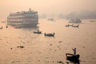 After the lull of the night, traffic resumes on the Buriganga River in Dhaka (Bangladesh, 2014).