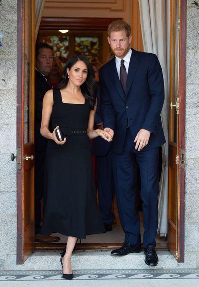 <p>Meghan Markle, wearing Emilia Wickstead, with Prince Harry in  Ireland, July, 2018</p>