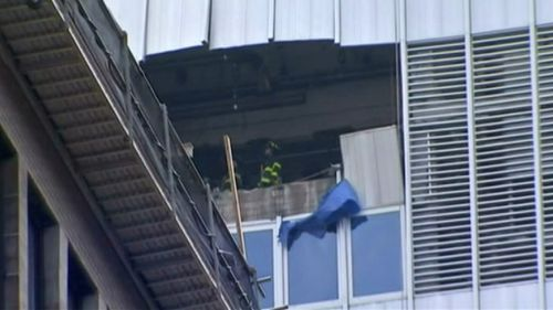 The falling unit smashed into the building on its descent. (9NEWS)