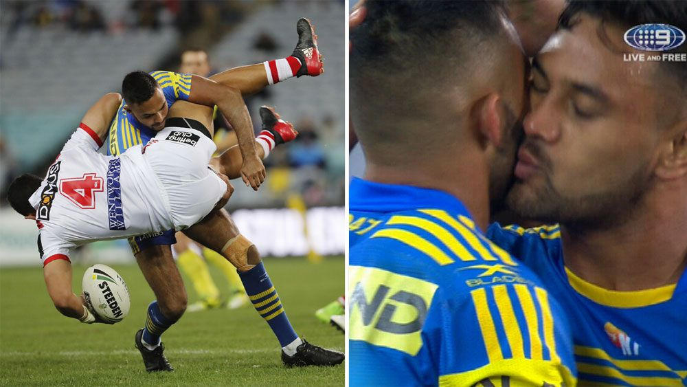 Parramatta winger Bevan French kissed by teammates Kenny Edwards for huge tackle