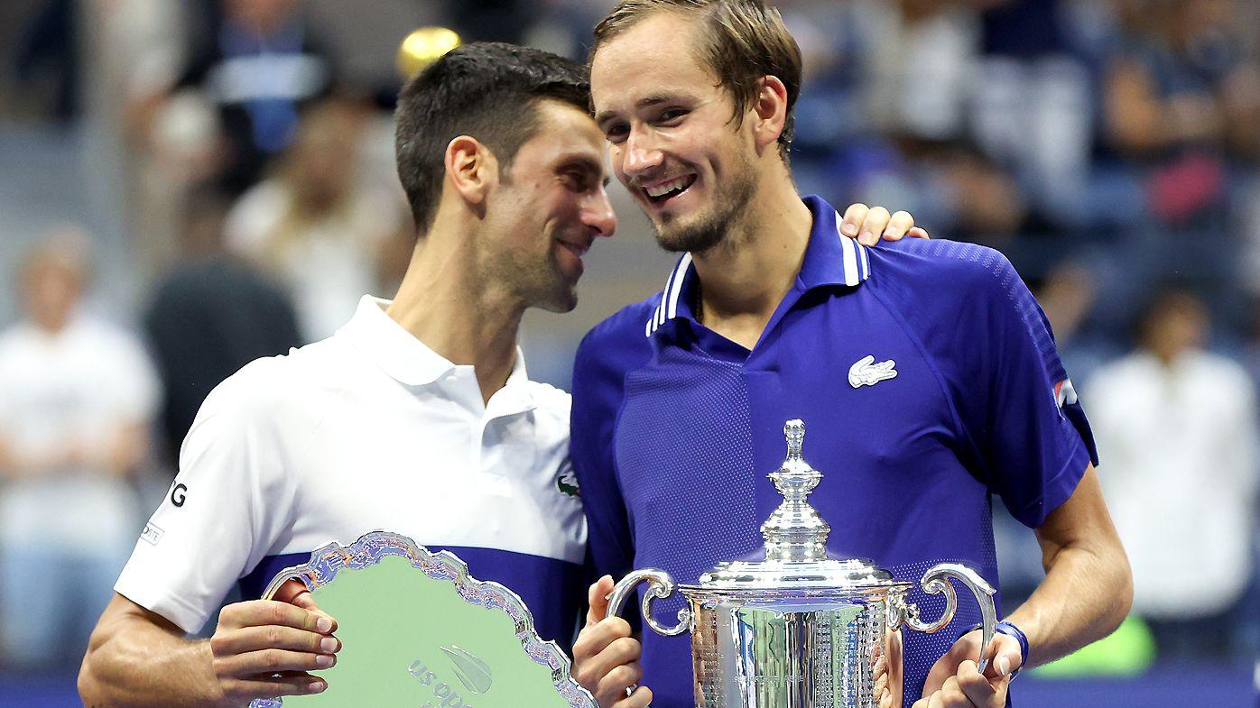 Daniil Medvedev and Novak Djokovic share a laugh during the trophy presentation