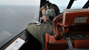Flying Officer Benjamin Hepworth searches from a Royal Australian Airforce AP-3C Orion for possible MH370 debris. (Getty)