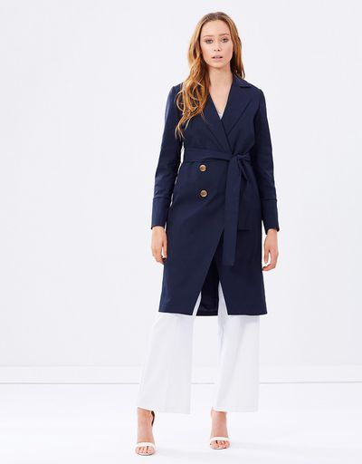 "<a href=""https://www.theiconic.com.au/shape-shifter-trench-coat-433184.html"" target=""_blank"" draggable=""false"">Friend of Audrey Shape Shifter Trench Coat in Navy, $129.95</a>"