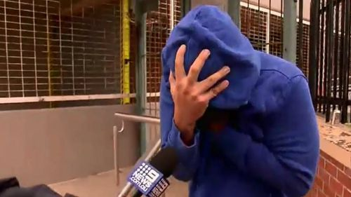 Eric Balanay has been accused of filming women in change rooms or the bathroom but outside court today he was camera-shy. Picture: 9NEWS