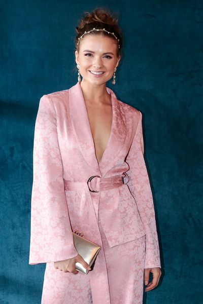 Laura Henshaw opted for winter pink jacket and trousers.