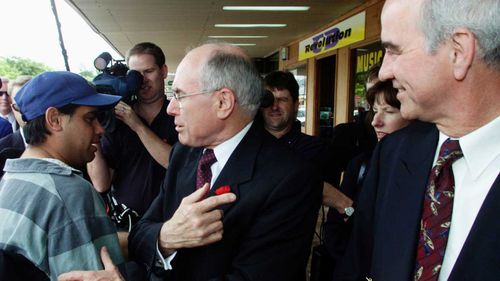 Prime Minister John Howard spruiks the virtues of Liberal candidate Gary Nairn in Queanbeyan, in the seat of Eden-Monaro in 2001.