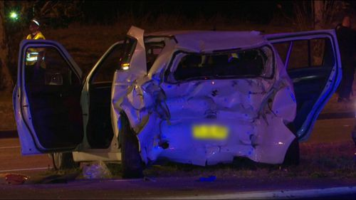 The woman was stopped at an intersection on the Great Western Highway when she was struck from behind by a truck.