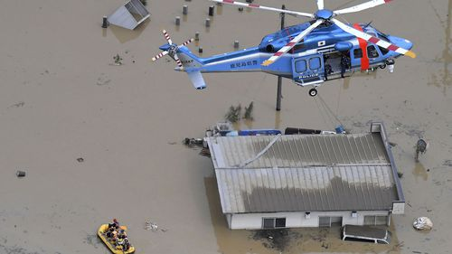 Rescue operation is conducted in a flooded area following a heavy rain in Hitoyoshi, Kumamoto prefecture, southern Japan Saturday, July 4, 2020.