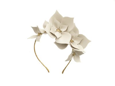 "<a href=""https://viktorianovak.com.au/collections/leather-headpieces/queen-of-spades-eggshell.html"" target=""_blank"">Viktoria Novak Queen of Spades eggshell headband, $825.&nbsp;</a>"