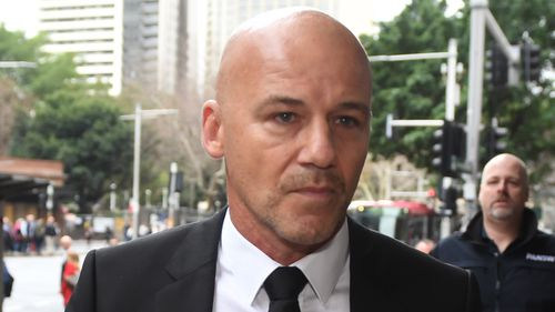 Former detective Gary Jubelin arrives at the Downing Centre Courts in Sydney.