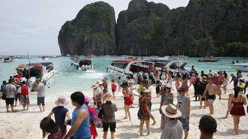 Crowds of visitors at Maya Bay in Thailand.
